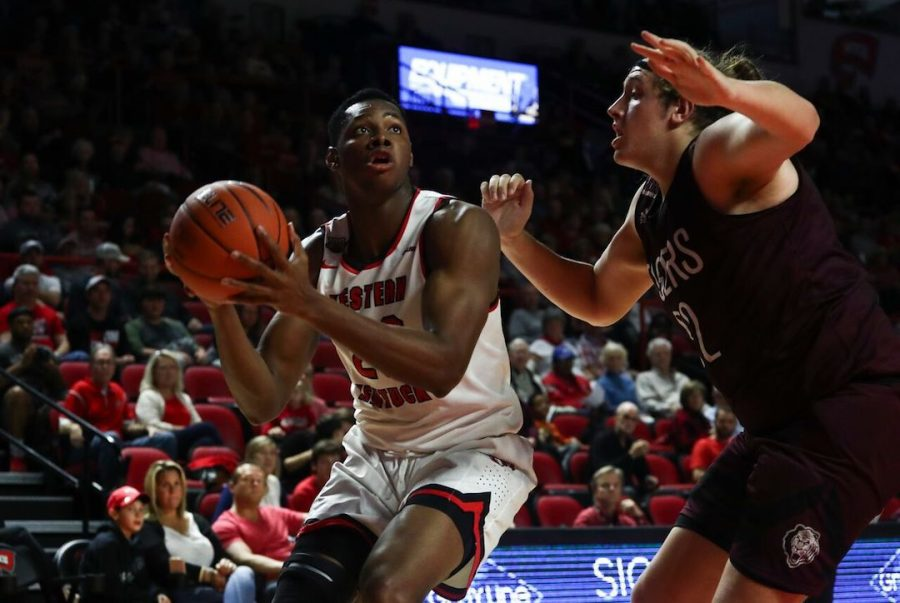 Freshman center Charles Bassey attempts a shot in the post against Campbellsville center Andrew Smith. Bassey scored 12 points and grabbed 11 rebounds in a 91-66 WKU win.