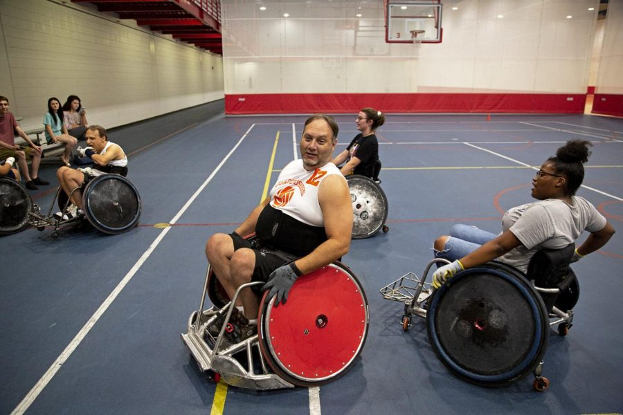 Travis Smith and other team mates settle down after a Murderball scrimmage in the Preston Center.