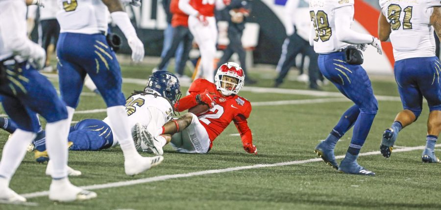 WKU wide receiver Jacquez Sloan (2) tackled by FIU defensive back Rishard Dames (35) during a homecoming football game 38-17 loss against Florida International university on Saturday, Oct 27, at Houchens L.T. Smith Stadium