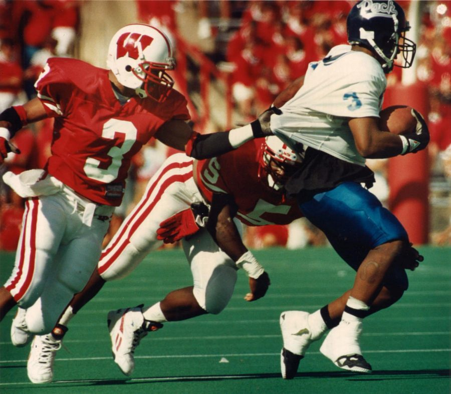 Badgers+cornerback+Kenny+Gales+%283%29+grabs+a+player+from+the+University+of+Nevada+during+a+game+Sept.+4%2C+1993%2C+at+Camp+Randall+Stadium.+The+Badgers+won%2C+35-17.