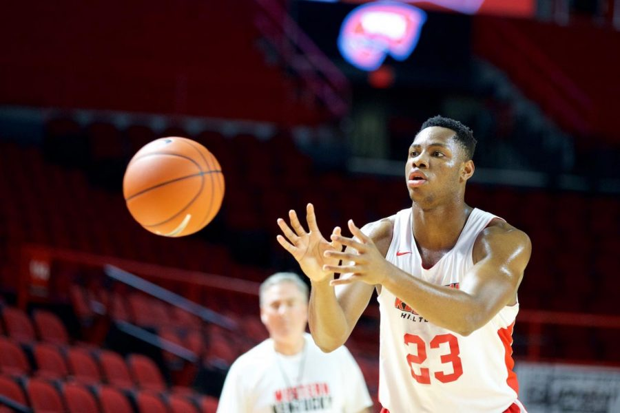 Freshman+center+Charles+Bassey+receives+a+pass+while+practicing+his+shooting+during+the+Hilltoppers%27+first-ever+basketball+pro+day+in+Diddle+Arena+Thursday.+Bassey+came+to+WKU+as+a+consensus+five-star+recruit.%C2%A0%C2%A0