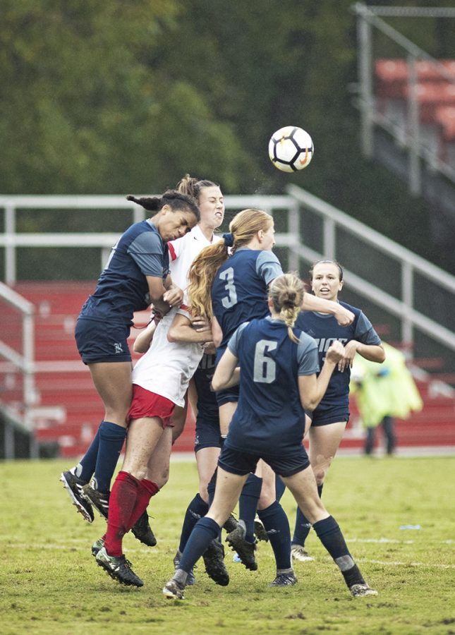 A+swirling+melee+of+WKU+Lady+Toppers+and+Rice%27s+Owls+battle+for+an+incoming+goal+kick%27s+dispersal+October+14+in+Bowling+Green.%C2%A0