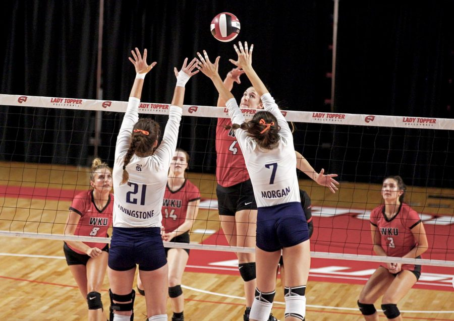 Middle+hitter+and+senior+Rachel+Anderson+%284%29+spikes+the+ball+over+the+net+past+Rice+senior+Shelby+Livingstone+%2821%29+and+Rice+Junior+Grace+Morgan+%287%29+in+a+3-1+loss+at+Diddle+Arena+September+30+in+Bowling+Green.
