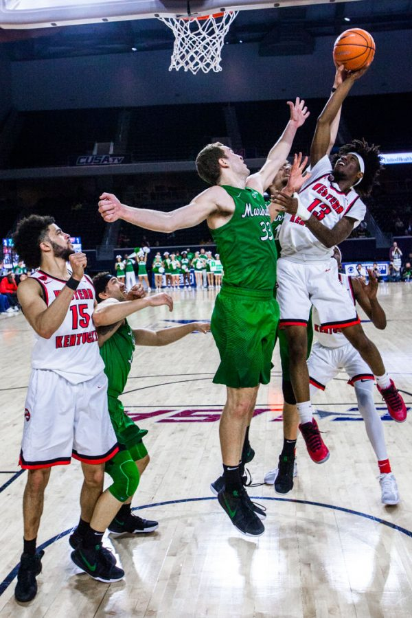 WKU+Guard+Taveion+Hollingsworth+%2813%29+attempts+to+shoot+for+two+as+his+shot+is+defended+by+Marshall+Guard+Jon+Elmore+%2833%29+during+the+Hilltoppers+67-66+loss+in+the+championship+game+of+the+Conference+USA+tournament+against+Marshall+University+on+Saturday+March+10%2C+2018+at+The+Star+in+Frisco%2C+Tx.