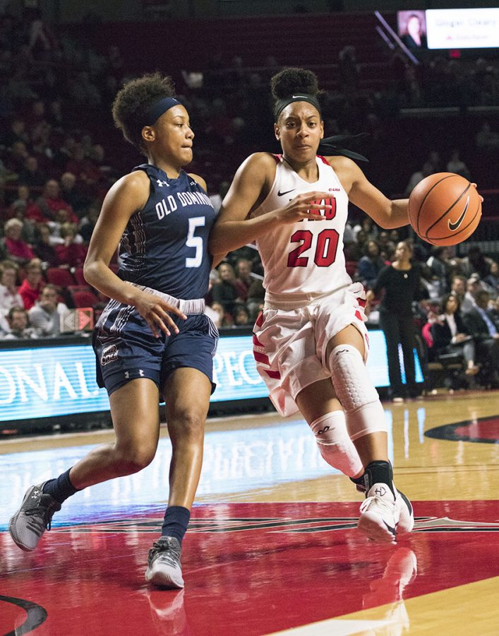 Sophomore+guard+Terri+Smith+drives+toward+the+basket+as+Old+Dominion+guard+Victoria+Morris+defends+her.+WKU+Lady+Toppers+played+Old+Dominion+on+Feb.+8+at+E.A.+Diddle+Arena.+The+Toppers+won+62-48.