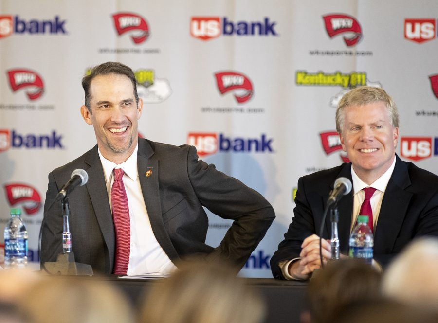 WKU's new head coach Tyson Helton (left) shares a smile with WKU athletic director Todd Stewart (right) during Helton's first press conference as the new head coach of the Hilltoppers at the Harbaugh Club in Houchens-Smith Stadium Nov. 27 in Bowling Green.