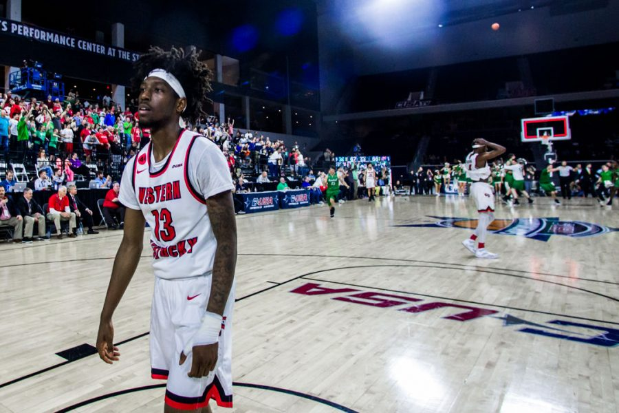 WKU Guard Taveion Hollingsworth (13) walks away following the Hilltoppers 67-66 loss in the championship game of the Conference USA tournament against Marshall University on Saturday March 10, 2018 at The Star in Frisco, Tx.