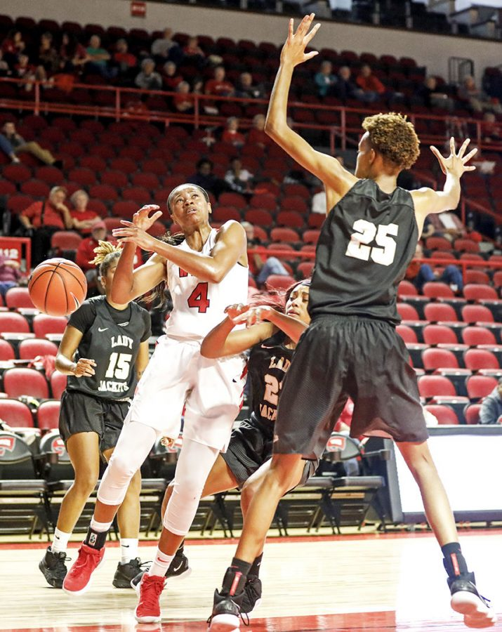 Redshirt+junior+guard+Dee+Givens+%284%29+attempts+to+shoot+for+two+as+she+defended+by+West+Virginia+guard+Jordan+Miller+%2823%29+and+West+Virginia+forward+Denisha+Bowman+%2825%29+during+the+Lady+Toppers%27+104-74+win+in+the+exhibition+game+against+West+Virginia+University+on+Thursday+Nov%2C+1%2C+at+the+E.A.+Diddle+Arena.