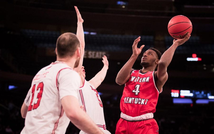 WKU+guard+Josh+Anderson+fights+off+defenders+on+his+way+to+the+basket+during+the+semifinals+of+the+NIT+Championship+in+Madison+Square+Garden+on+Tuesday+night.