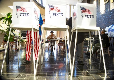 Voters cast their votes at the Bowling Green Towers polling station only an hour after opening at 6 a.m.