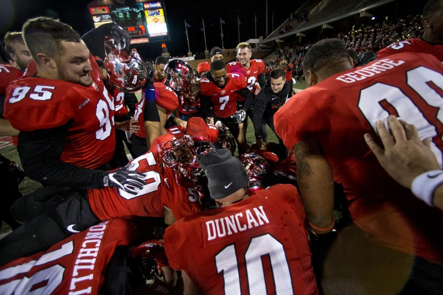 Teammates pile on WKU kicker Ryan Nuss (37) after he kicked a field goal to win in triple over time during WKU's game vs MTSU on Friday Nov 17, 2017 in L.T. Smith Stadium.