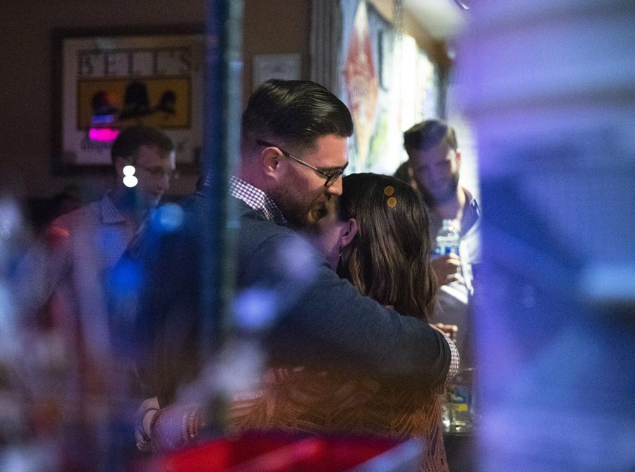 Ben Lawson hugs his wife, Mollie, as he waits for the results of the mid term elections at Blue Holler Brewery Nov. 6 in Bowling Green, Kentucky.
