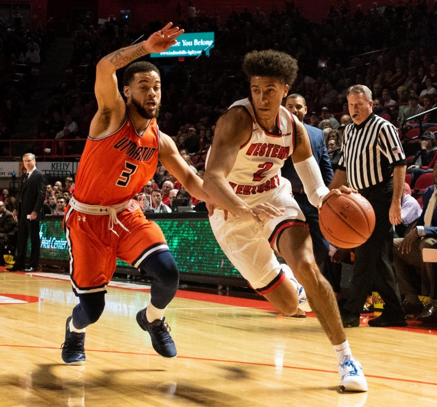 WKU wing Jared Savage (2) takes the ball inside during WKUs win over UT Martin in Diddle Arena Saturday. Savage scored 16 points.