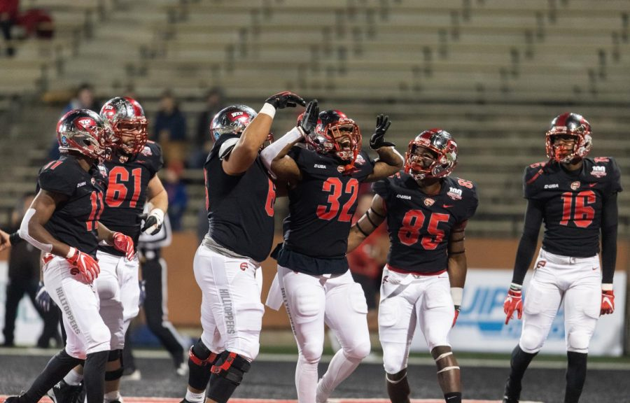 WKU running back D'Andre Ferby (32) celebrates a touchdown in the first quarter during the football game between UTEP and WKU at Houchens-Smith Stadium on Nov. 17. The Hilltoppers won 40-16.