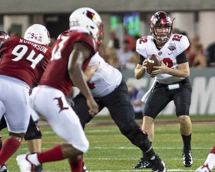 Freshman+quarterback+Davis+Shanley+gets+ready+to+pass+the+ball+during+WKU%27s+football+game+against+Louisville+on+Saturday.+WKU+lost+the+game+20-17.