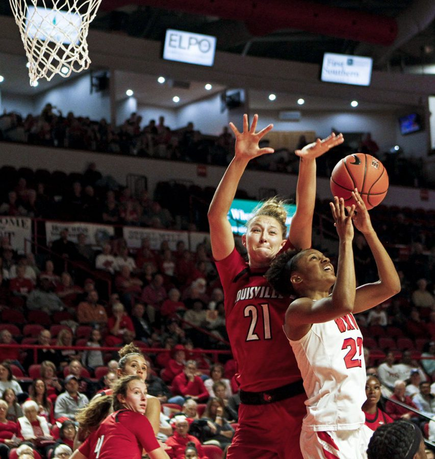 Lady+topper+sophomore+Sherry+Porter+%2825%29+attempts+to+shoot+for+two+as+she+defended+by+Louisville+forward+Junior+Kylee+Shook+%2821%29+during+the+Lady+Toppers%27+102-80+loss+in+the+first+USA+conference+game+against+Louisville+University+on+Tuesday+Nov%2C+6%2C+at+the+E.A.+Diddle+Arena.