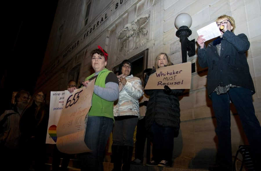 Protestors gathered outside the Warren County Justice Center on Thursday night to rally against President Trump's firing of Attorney General Jeff Sessions. They marched from the justice center to Circus Square Park.