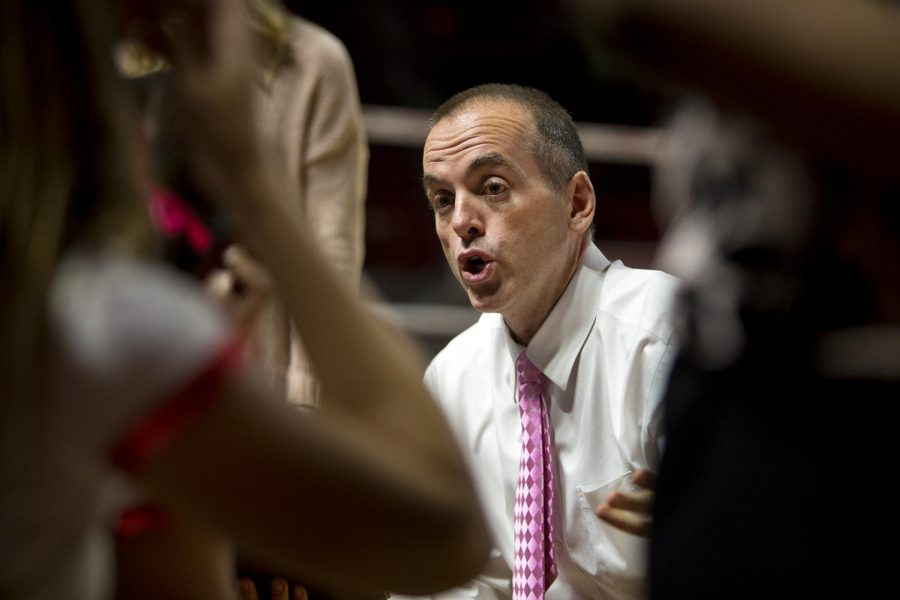 Head coach Travis Hudson speaks to his team during a timeout in the Lady Toppers' matchup against Texas-El Paso.