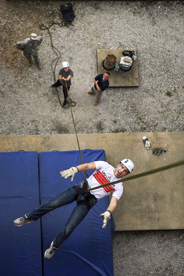 Freshmen+ROTC+member+Peter+Fields+from+Erlanger%2C+Kentucky+practices+a+fall+while+rappelling+off+the+side+of+Parking+Structure+1+as+part+of+the+curriculum+for+his+Military+Science+101+class+Wednesday.+%22This+is+my+first+time+rappelling.+I%27m+actually+afraid+of+heights%2C+so+this+is+a+fun+learning+experience%2C+overcoming+fears.%22+Gabriel+Scarlett%2FHERALD.