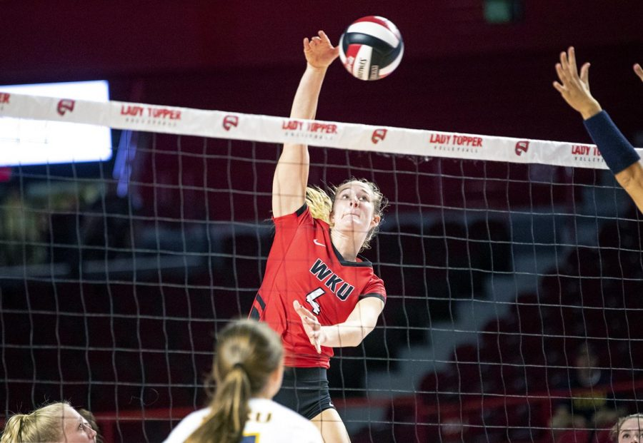 Senior+middle+hitter+Rachel+Anderson+%284%29+spikes+the+ball+over+the+net+past+ETSU+for+one+of+her+10+kills+at+Diddle+Arena+Sept.+14.+Anderson+had+10+kills+and+four+blocks+for+the+Lady+Toppers+in+a+3-0+win+against+the+Bucs.