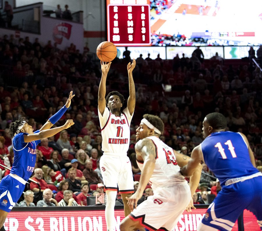 WKU%E2%80%99s+Taveion+Hollingsworth+%2811%29+shoots+from+outside+against+Tennessee+State+on+Saturday.+Hollingsworth+scored+19+points+in+the+Hilltoppers%E2%80%99+88-74+win+at+Diddle+Arena.