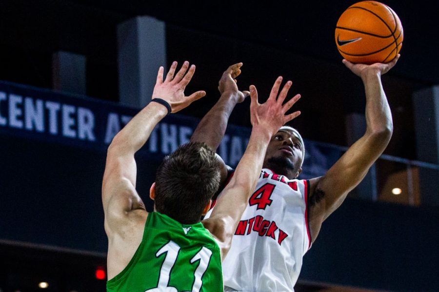 WKU+Guard+Josh+Anderson+%284%29+shoots+for+two+as+he+is+defended+by+Marshall+Forward+Ajdin+Penava+%2811%29+during+the+Hilltoppers+67-66+loss+in+the+championship+game+of+the+Conference+USA+tournament+against+Marshall+University+on+Saturday+March+10%2C+2018+at+The+Star+in+Frisco%2C+Tx.