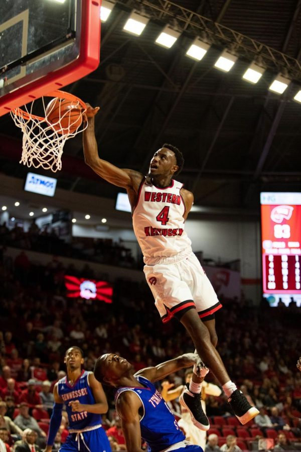WKU forward Josh Anderson dunks over a Tennessee State defender during WKU's win over TSU. Anderson scored 15 points in the win.