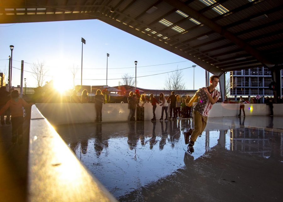 Skaters+round+a+corner+of+the+SoKY+Ice+Rink+on+Sunday+afternoon.+Temperatures+reached+a+high+of+65+F+which+resulted+in+some+slushy+areas+of+the+rink.+The+rink+is+6%2C000+square+feet+and+accommodates+up+to+175+skaters.
