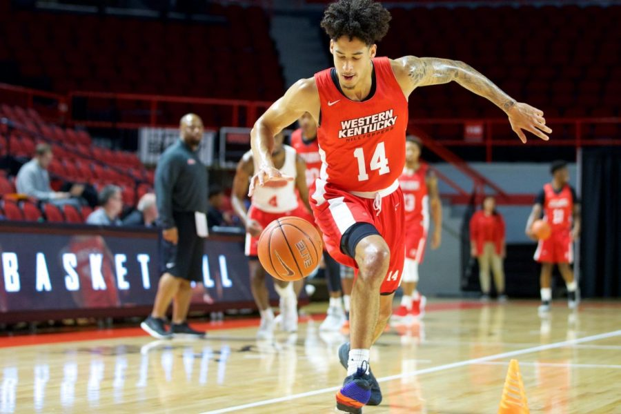 Sophomore+Marek+Nelson+drives+to+the+hoop+around+a+set+of+cones+during+WKU%27s+first+basketball+pro+day+Thursday+in+Diddle+Arena.+Nelson+is+one+of+seven+returning+players+on+this+year%27s+roster.%C2%A0