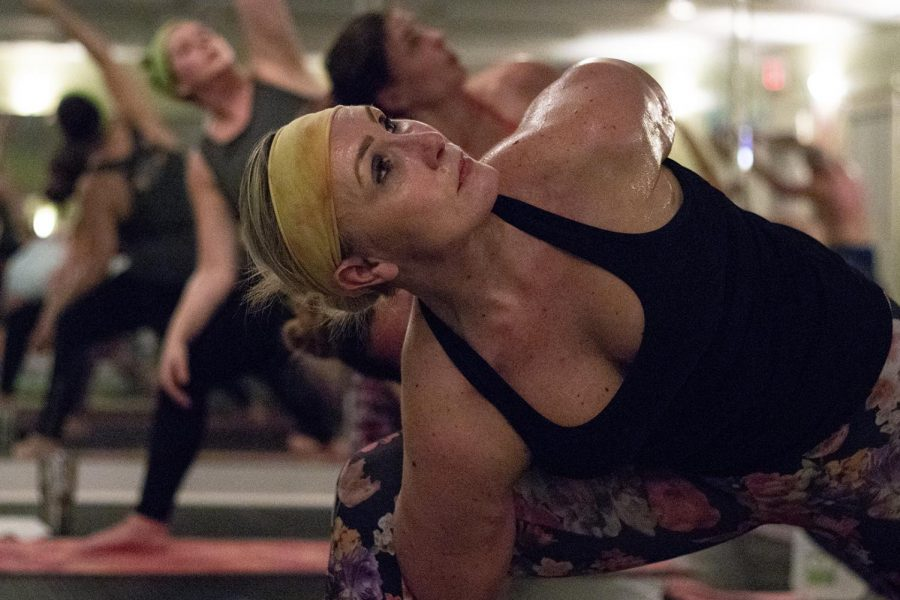 Kelly Rice practices advanced yoga poses during the Hot Yoga Traditional/ Blend class on Jan. 23, 2019. This class welcomes all levels of yoga including beginners.