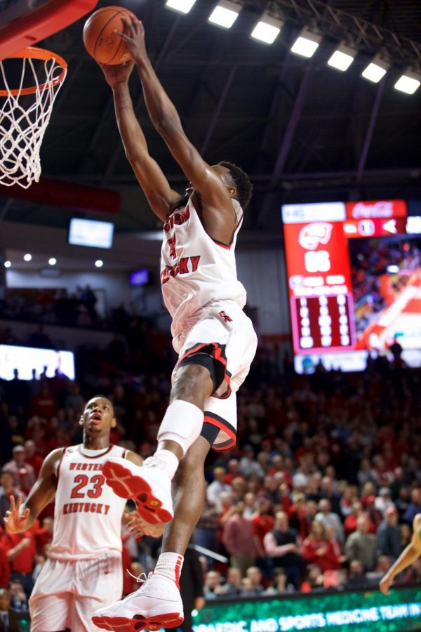 Sophomore guard Josh Anderson dunks the ball while freshman center Charles Bassey looks on in the closing minutes of WKU's 68-59 victory over Marshall in Diddle Arena on Monday.