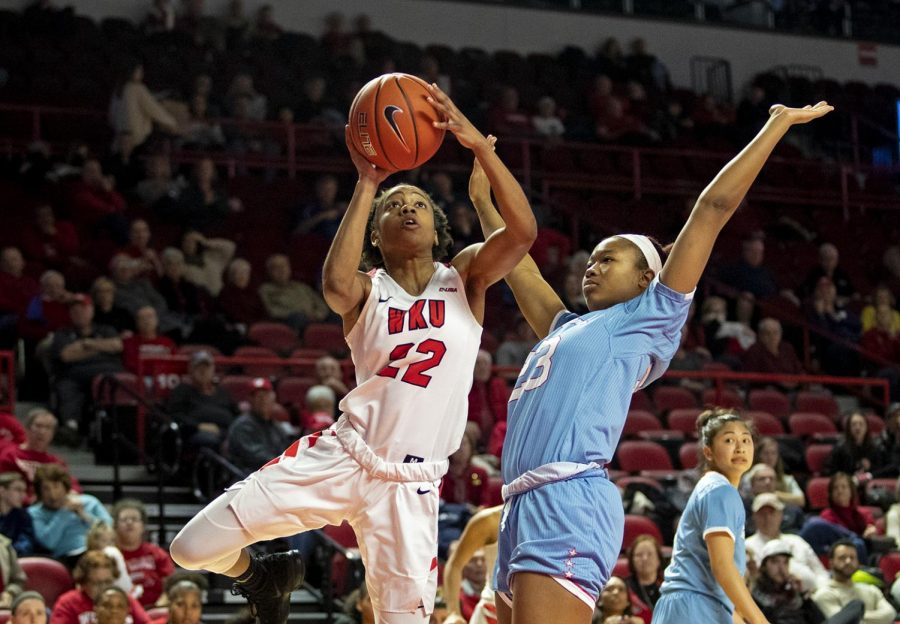 WKU%27s+sophomore+guard+Sherry+Porter+drives+to+the+hoop+in+Diddle+Arena+on+Jan.+26.+WKU+beat+Louisiana+Tech+with+a+score+of+81-76.+CHRIS+KOHLEY%2FHERALD
