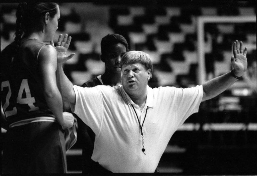 Lady Topper head coach Paul Sanderford gives direction to one of his players during a practice session.