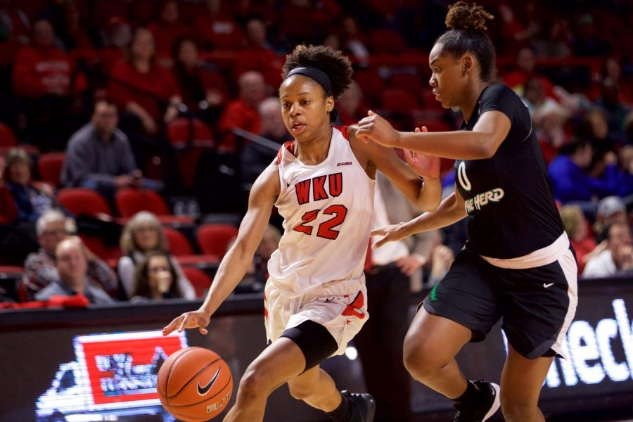 Sophomore guard Sherry Porter battles a defender during the Lady Toppers 85-55 win over Marshall at Diddle Arena on Saturday. Porter finished with a career high 20 points in the victory.