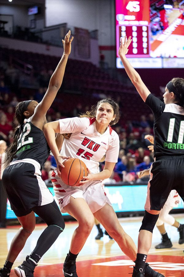 Raneem+Elgedawy+drives+to+the+net+while+being+fouled+by+Southern+Illinois+University%27s+defense+in+Diddle+Arena+on+Nov.+20.