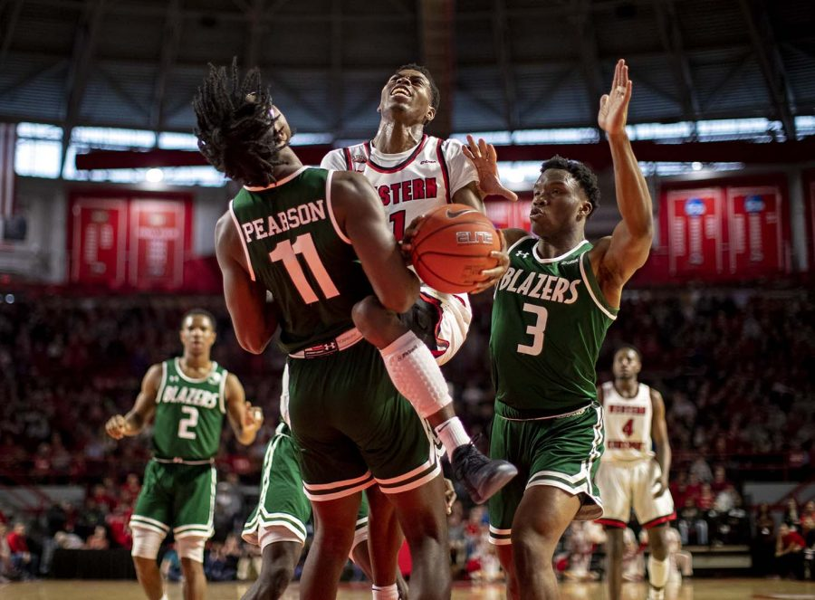 Hilltopper+guard+Lamonte+Bearden+earns+a+charge+driving+through+the+lane+on+Feb.+16+at+E.A.+Diddle+Arena.+Bearden+scored+7+in+the+68-60+loss.