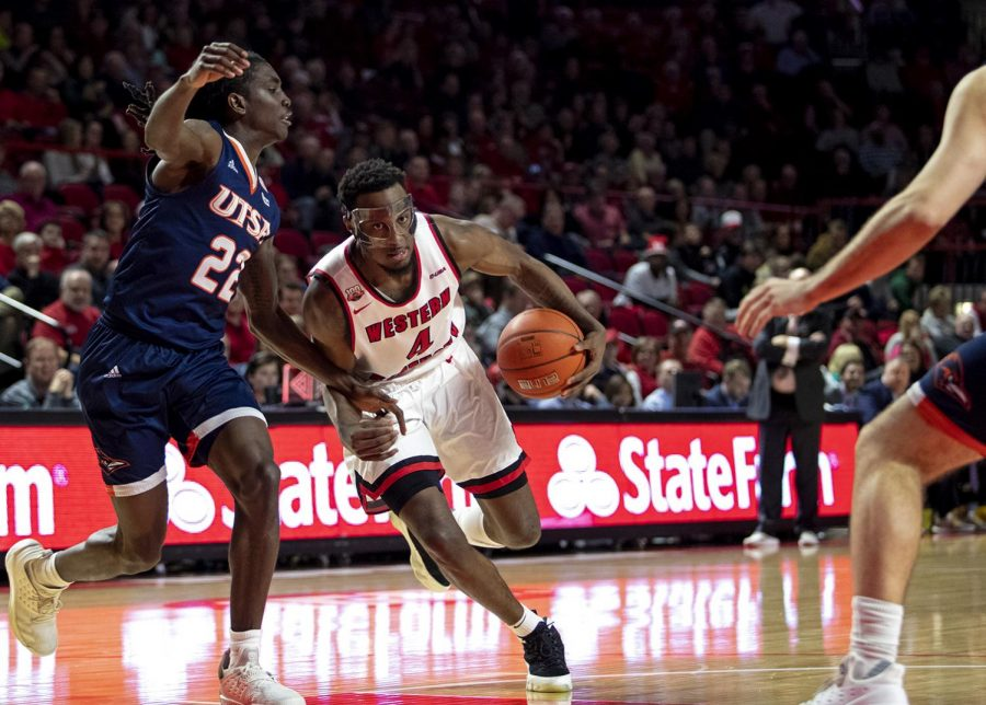 WKU+guard+Josh+Anderson+charges+for+the+basket+on+Jan.+31%2C+2019+at+Diddle+Arena.+The+Hilltoppers+pull+a+win+against+UTSA+with+a+score+of+96-88.