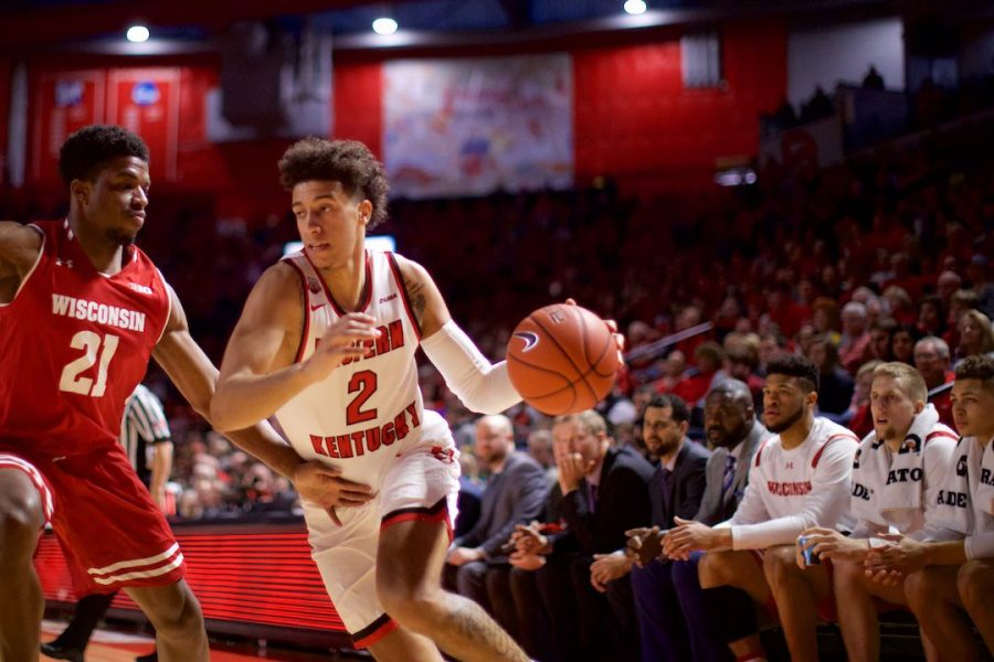 Wisconsin%27s+bench+watches+as+WKU%27s+Jared+Savage+%282%29+drives+in+on+Khalil+Iverson+%2821%29+in+Diddle+Arena+Dec.+29+in+Bowling+Green.+Savage+had+16+points+and+five+rebounds+in+the+win.%C2%A0