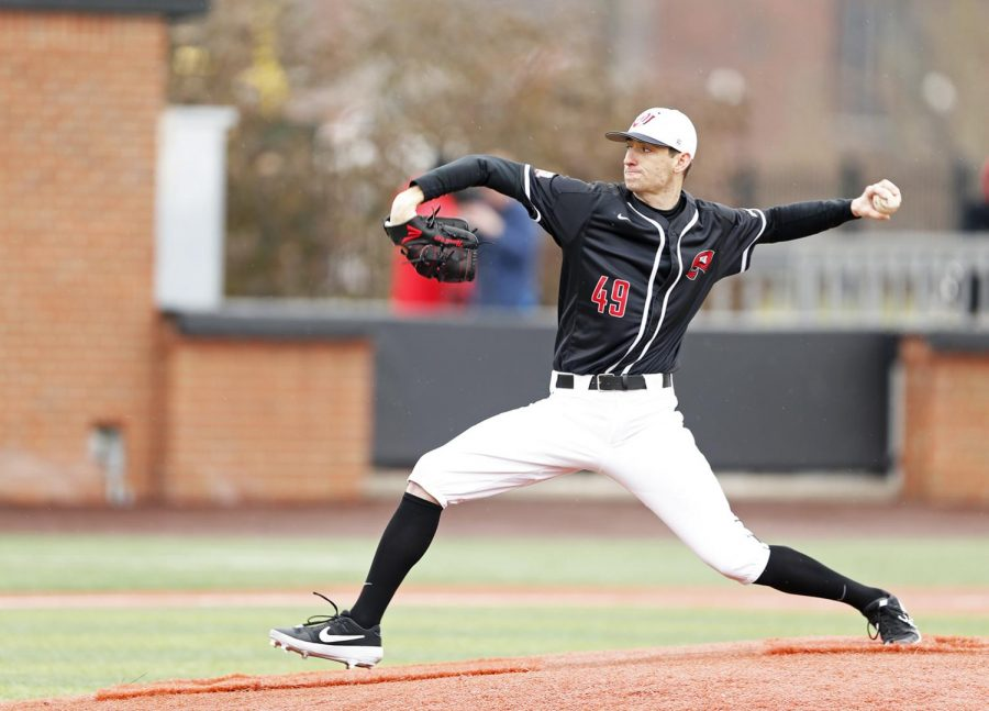 Right handed pitcher junior Eric Crawford (55) pitches the ball towards Northern Kentucky infield freshman Noah Fisher (12) during WKU's 9-6 win against Northern Kentucky University on Friday, Feb 15 at Nick Denes Field.