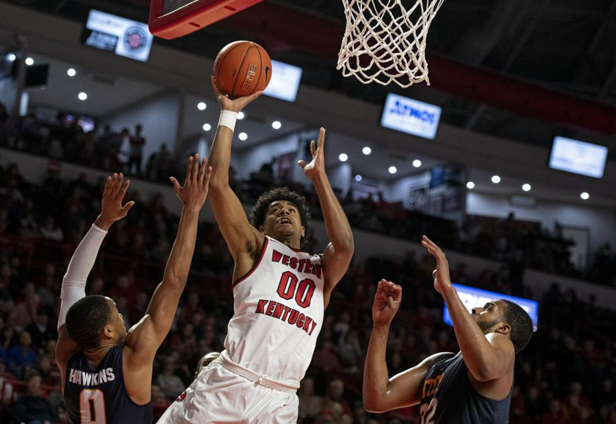 WKU freshman forward Tolu Smith goes up for a shot against two UTEP players during a game at Diddle Arena on Feb. 2, 2019. The Hilltoppers came out on tope beating UTEP with a final score of 76-59.