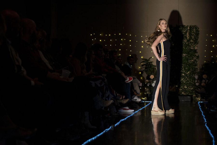 Macy+Preston+takes+her+second+walk+down+the+runway+wearing+a+striped+jumpsuit+styled+for+a+future+career+as+a+boutique+owner.+The+fashion+show%2C+titled+%E2%80%9CPicture+This%3A+A+Snapshot+into+your+Future+Career%E2%80%9D%2C+was+meant+to+show+people+options+on+how+they+could+dress+for+a+certain+career+field.