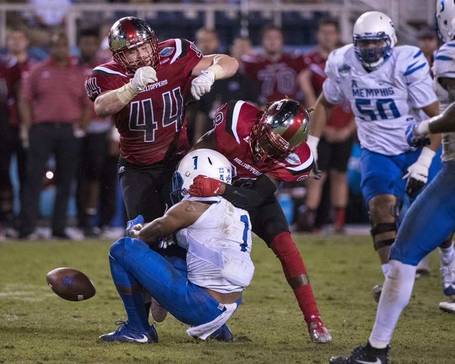 Redshirt freshman linebacker Ben Holt (44) and sophomore defensive back Drell Greene (28) cover University of Memphis' wide receiver Tony Pollard (1) during WKU's 51-31 win in the Boca Raton Bowl on Tuesday, Dec. 20, 2016, at FAU Stadium in Boca Raton, Fla.