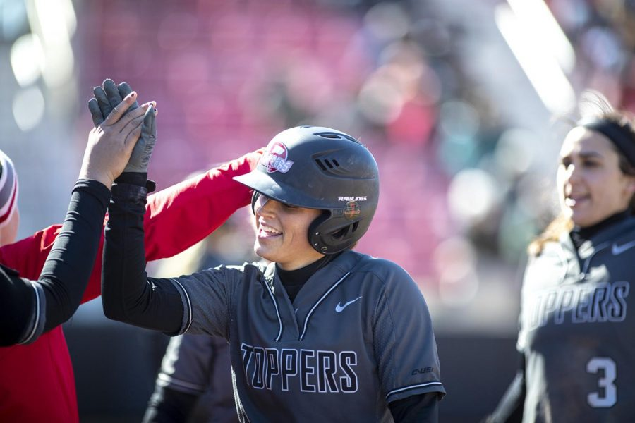 WKU%E2%80%99s+Rebekah+Engelhardt+gets+high-fives+from+her+teammates+in+the+2+inning+after+scoring+a+run+against+Butler+University+during+the+WKU+Hilltopper+Classic+at+the+WKU+Softball+Complex+Feb.+24+in+Bowling+Green.+Both+Englelhardt+and+Morgan+McElroy+%28not+pictured%29+would+score+2+of+WKU%E2%80%99s+final+3+points+on+an+RBI+single+by+Maddie+Bowlds.