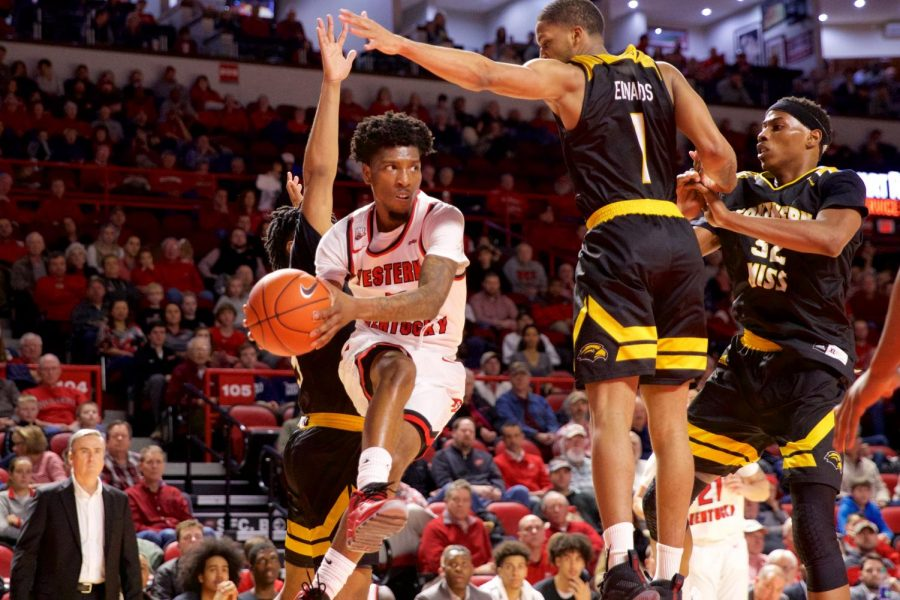Sophomore guard Taveion Hollinsworth looks for a passing lane during the Hilltoppers' 76-71 victory over Southern Mississippi on Sunday in Diddle Arena.
