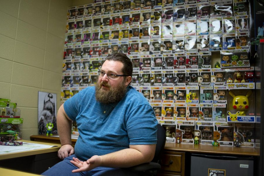 Assistant+professor+Joseph+Hoffswell+collects+action+figures+in+his+office+at+the+department+of+communication+in+the+Fine+Art+Center.+%22My+dad+was+a+collector+too%2C+he+was+a+comic+book+collector+and+that+stuff+hits+home%2C%22+Hoffswell+said%2C+%22I%27ve+been+collecting+since+I+was+a+high+schooler+...+and+when+I+was+in+my+Ph.D.+I+started+getting+into+the+Funko+Pops+behind+me%2C+I+had+a+couple+but+I+started+seriously+collecting+in+2013+or+so.%22