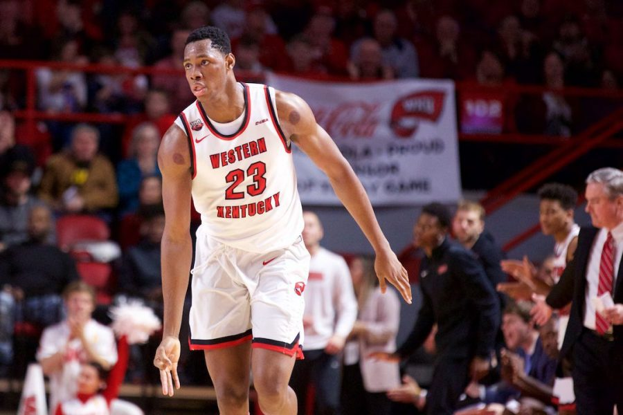 Charles Bassey (23) celebrates after making a shot against Wisconsin in Diddle Arena Dec. 29 in Bowling Green. Bassey had 19 points and six rebounds in the win.