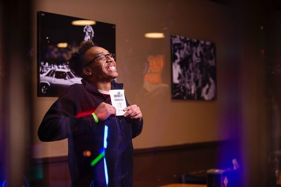 Albert Taylor known as (Tre) from Louisville poses in front of the Big Brother crew in the audition room at Larry's Pizza on Thursday, March 28.