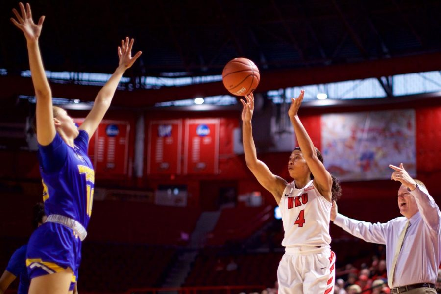Redshirt+junior+Dee+Givens+takes+a+shot+during+the+Lady+Toppers%27+68-65+win+over+Morehead+State.+Givens+finished+with+23+points.