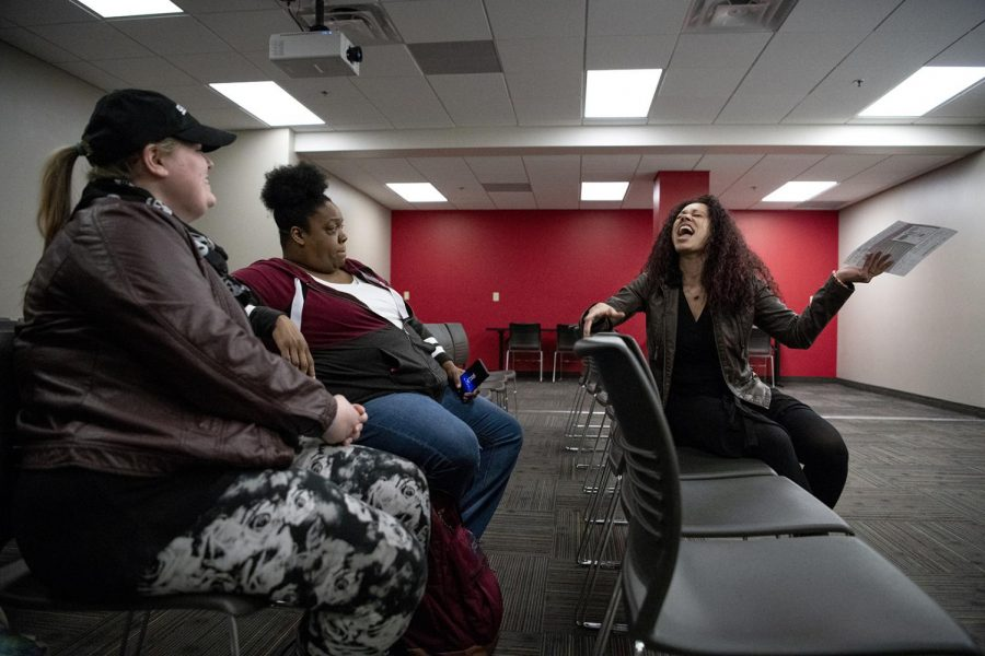 WKU Dr. Lacretia Dye, far right, welcomes Bowling Green High School English teachers Jennifer Harrell, far left, and Natalie Corney before the start of the Black Minds Matter workshop session at Downing Student Union on Saturday, March 16, 2019. Dye, who leads the workshop sessions along with her grad assistant, discussed the upcoming Project LIT, literature in the community, book giveaways and discussions, with the teachers.