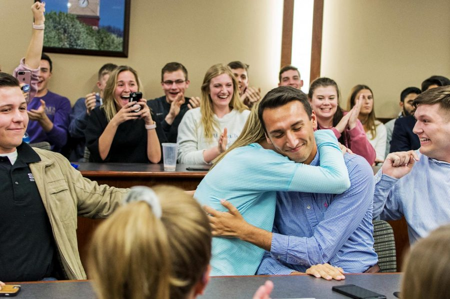 WKU Student Body President elect Stephen Mayer hugs his administrative vice president Harper Anderson after hearing that their ticket won the SGA election. A crowd gathered in DSU until after midnight on April 18 to hear the results.